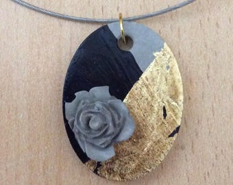 Pendant in concrete, oval with rose and finished with gold leaf