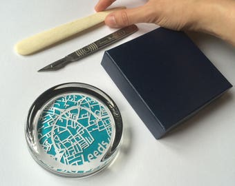 Handcut map of Leeds protected in a glass paperweight
