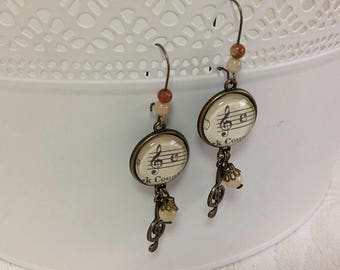Music, long, earrings decorated with clef, vintage style.