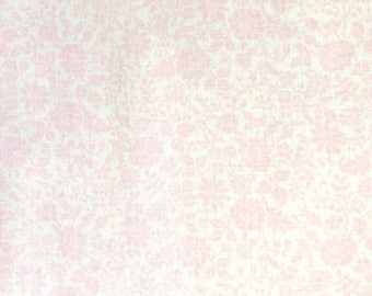 Soft cotton in pastel colors, pink flowers on white background