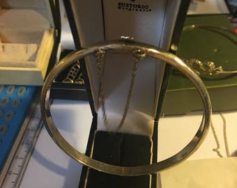 Vintage sterling silver plain bangle with safety chain