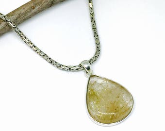 Rutilated Quartz Pendant set in sterling silver 925. Natural authentic stone.