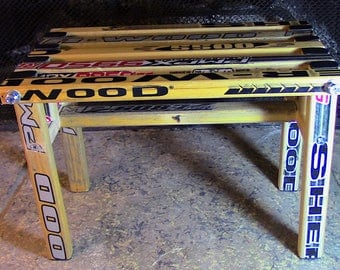 Footstool constructed/upcycled from vintage wooden Sher-Wood hockey sticks (Russian and Ukrainian manufactured sticks)