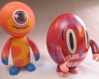 2 collectible Millennial toys.