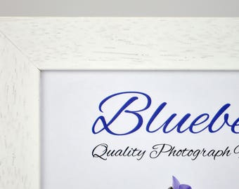 White painted wooden frame - supplied with Plexiglass