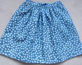 girl in blue soft denim skirt