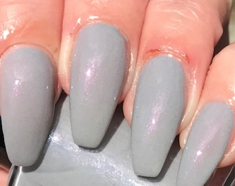 Jesn Pool cream gray with pink bronze shimmer nail polish