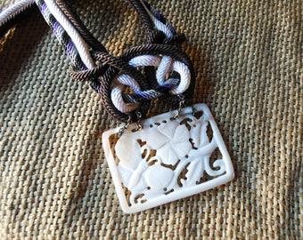 Philippines vintage mop carved pendant