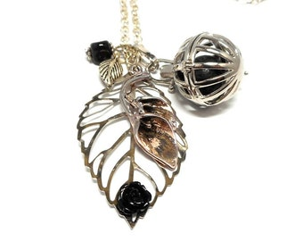 A scent! a silver necklace perfume leaf, black beads
