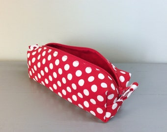 Red pen Kit with white polka dots.