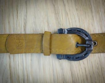 Custom leather belt with blacksmith made buckle horseshoe.