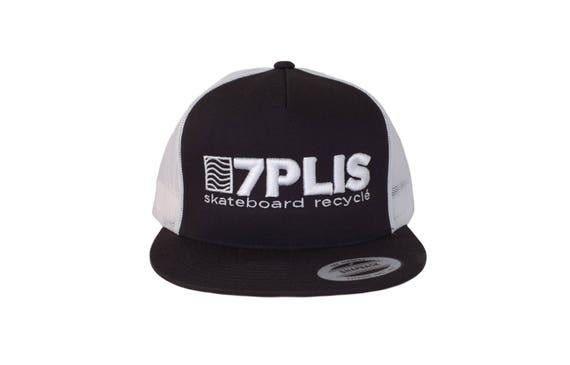Black and white embroidered 7PLIS trucker cap