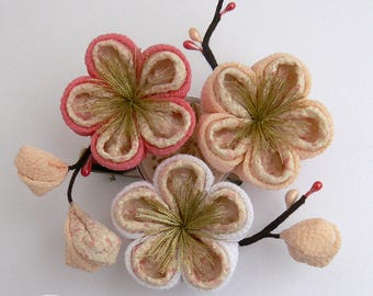Ume tsumami kanzashi, japanese plum hairclip and brooch, silk flowers traditionally worn in February.
