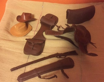 Lot of 7 vintage Johnny West accessories - saddle, saddlebags, horse blanket, rifle and case, 2 hats, whip