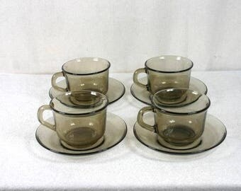 4 Cups And Saucers From Arcoroc France Vintage Retro Set Arcoroc Smoked Glass Cup And Saucer Set