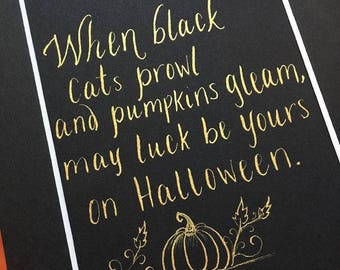 When black cats prowl//Halloween quote