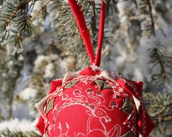 Red quilted Christmas bauble with hand-printed picture