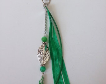 Green bag with ribbons and beads