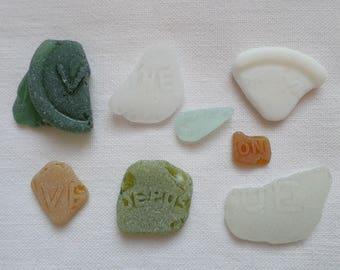 Genuine sea glass, Printed sea glass, Polished glass by the sea, Inscription on sea glass, Polished bottle bottoms.