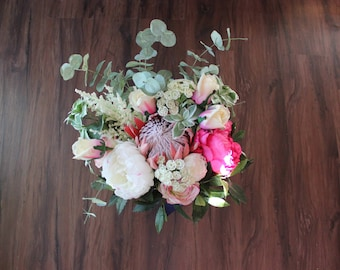 Large Garden Boho bouquet in bright pinks and whites. King Protea, Peonies, roses, astilbe, queen ann's lace and eucalyptus and bay leaves.