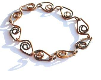 bespoke jewellery in antique bronze,  spiral link design bracelet