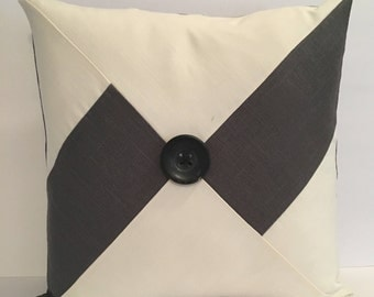 Gray and off-white linen pillow with large gray button