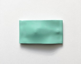 Green glossy faux leather snapclip