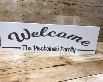 Welcome sign| family name sign| front door| entry way sign| wooden sign