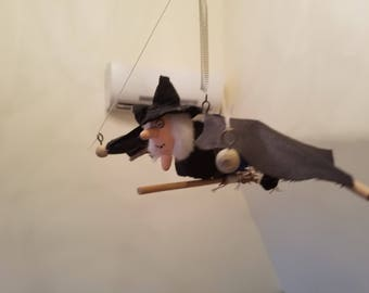 The flying Which on a Broom bouncing doll
