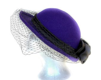 1960s purple wool dress hat with black Birdcage veil, satin band and fabric flowers by Michael Howard, trademark signed