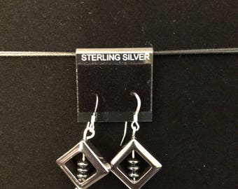Spin and dangle earrings