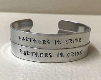 2 Partners In Crime cuff bracelets. Aluminum or Copper.
