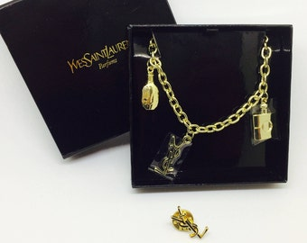 Bracelet and pin YSL