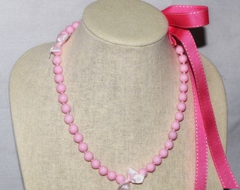 Girls pink bead necklace