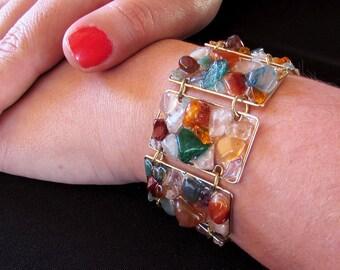 Elegant bracelet made of bronze and mosaic of gemstones - quartz, conrelian, citrine, jasper