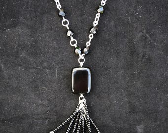 Black and silver-plate flapper vintage 1920s pendant