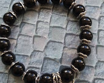 Black, glass beaded bracelet, butterfly charm, elasticated