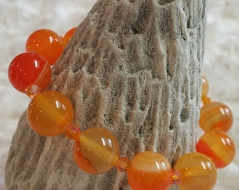 Light orange agate beaded bracelet with orange crystals