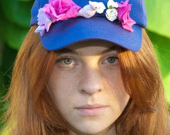 Cap with flowers and porcelain bird