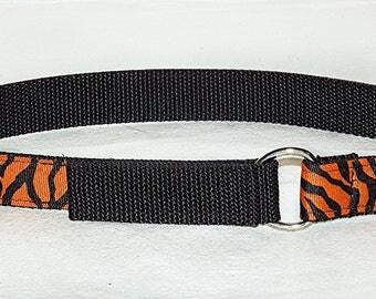 tiger print on orange background toddler belt on black nylon web