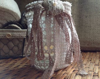 Shabby chic candle covered with lace
