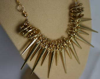 old gold spikey necklace with chain back