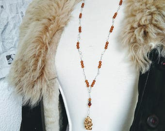 Amber necklace and Tiki