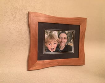 8x10 cherry picture frame with an artistic style