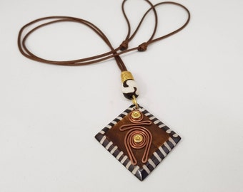 African Inspired Square Shaped Pendant. Hand-Made Bone Batik infused with Brass