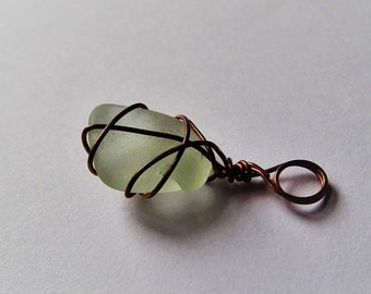 Handmade wire wrapped sea glass pendant