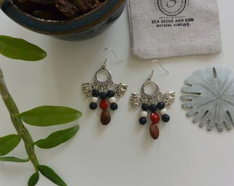 Earrings made of seeds with elephants