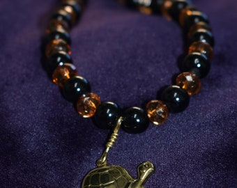 Amber and black turtle necklace