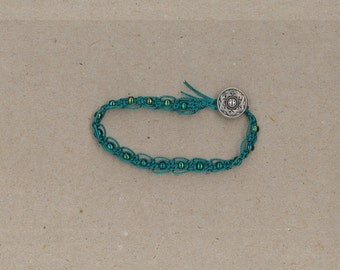 Handmade green macrame bracelet with green glass beads and button clasp by TwistedandKnottyUS
