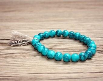 Articles similaires bracelet pastel perles fimo turquoise ivoire orange avec pompon et plume - Anneau de gland ...